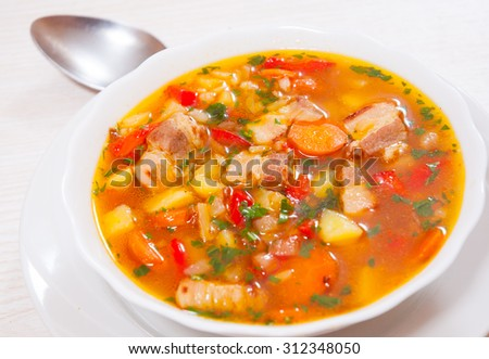 soup with meat, rice and vegetables #312348050