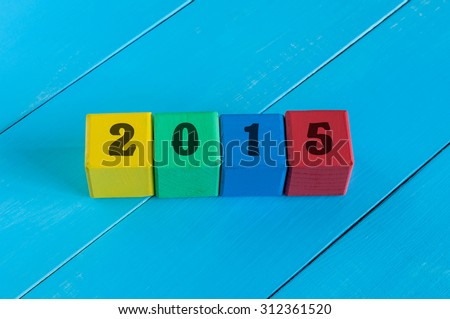 Numeral 2015 on children's colourful cubes or blocks