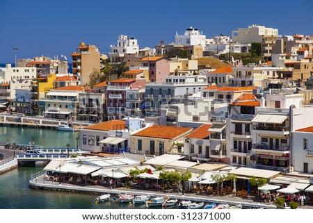 AGIOS NIKOLAOS, CRETE, GREECE - MAY 6, 2015: Seaside resort town of Agios Nikolaos located on the north-east side of Crete, Greece. #312371000