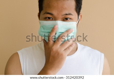 Asian man wearing a face mask #312420392