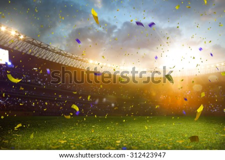 Evening stadium arena soccer field championship win! Confetti and tinsel . Yellow toning Royalty-Free Stock Photo #312423947