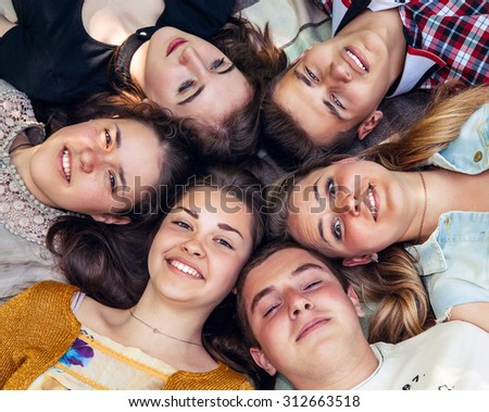 Teenage friends lying together in circle #312663518