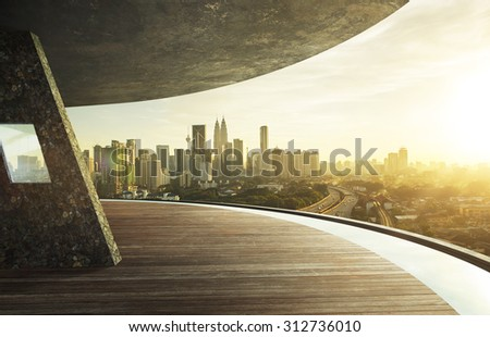 View from open space balcony, Kuala Lumpur city centre during sunset. Royalty-Free Stock Photo #312736010