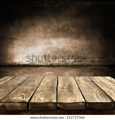 dark blurred wall of brown color and dark shadows with desk top place  #312737366