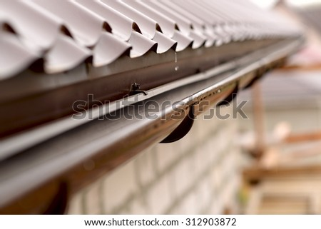 Holder gutter drainage system on the roof #312903872