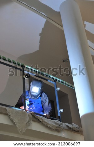 "Worms, Germany - January 6, 2011 - Workers in new event center ""The Wormser""  #313006697"