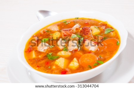 Fish soup with vegetables #313044704