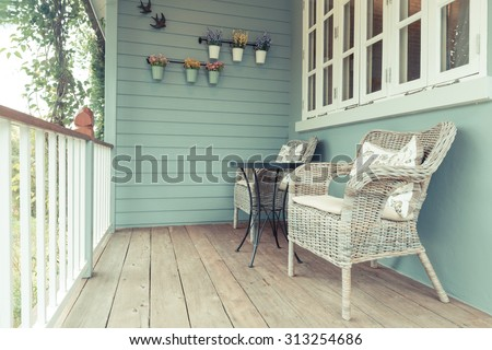 Beautiful terrace or balcony with small table, chair and flowers. Vintage image terrace home balcony view.