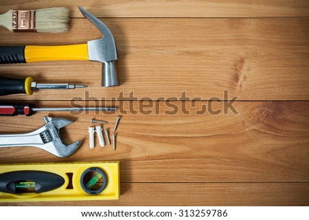 Closeup of assorted work tools on wood #313259786