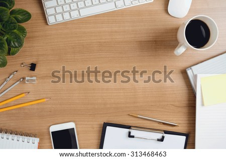 Office desk table with computer, smartphone, supplies, flower and coffee cup. Top view with copy space. Concept for website banner, mockup, background, presentation and marketing material.