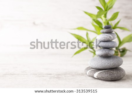 Spa stones on the grey background.