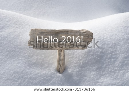 Wooden Christmas Sign With Snow In Snowy Scenery. English Text Hello 2016 For Seasons Greetings Or Christmas Greetings Or Happy New Year Greetings. Christmas Atmosphere.