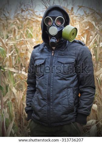 man gas mask gun concept the danger of war #313736207