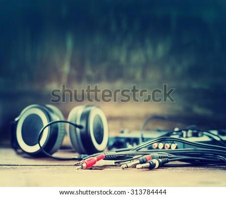 DJ equipment on rustic wooden background