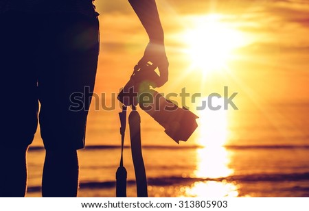 Sunset Photography. Photographer Ready to Take Sunset Pictures on the Beach. Professional Travel Photography Works. Royalty-Free Stock Photo #313805903