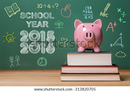 School year 2015-2016 with pink piggy bank in front of a chalkboard