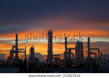 Silhouette of petrochemical plant or Oil and gas refinery at twilight #313823516