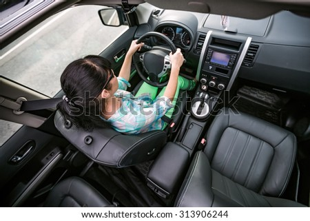 Woman rides on the car at high speed. #313906244