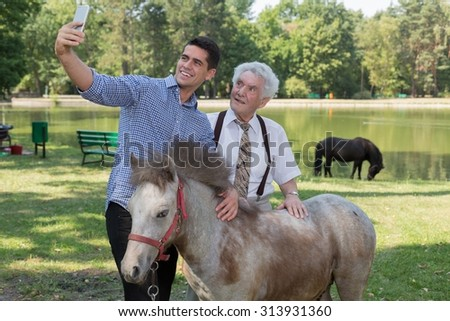 Photo of man taking selfie with grandfather and ponytail #313931360