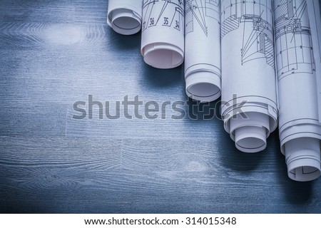 copyspace image rolls of blueprints on blue board. Royalty-Free Stock Photo #314015348