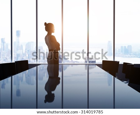 woman looking at modern city Royalty-Free Stock Photo #314019785