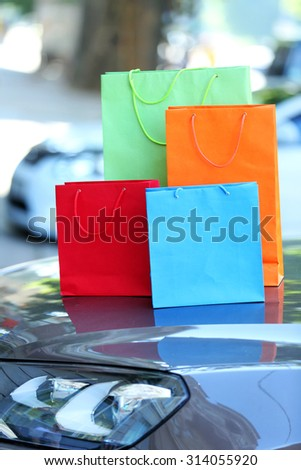 Bright shopping bags outdoors #314055920
