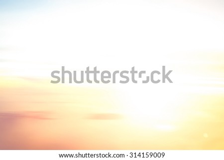 Summer holiday concept: Abstract blurred white sun light pattern on autumn sunrise background