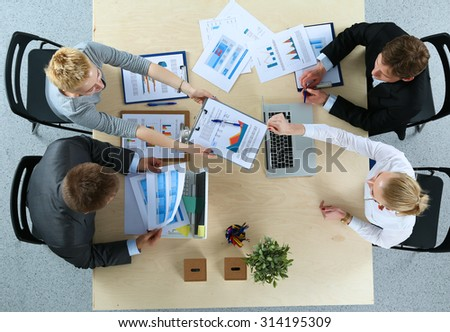 Business people sitting and discussing at business meeting, in office #314195309