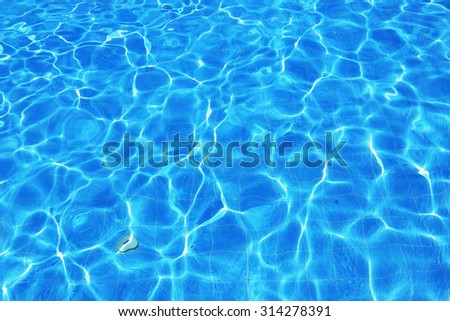 isolation Azure water outdoor swimming pool with reflections of sunlight  #314278391
