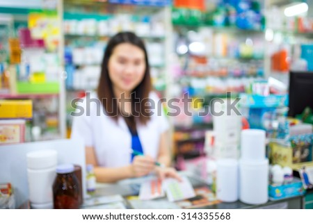 Blurred image of young female pharmacist in the pharmacy drugstore #314335568