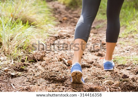 Close up view of athletes legs on trail in the nature #314416358