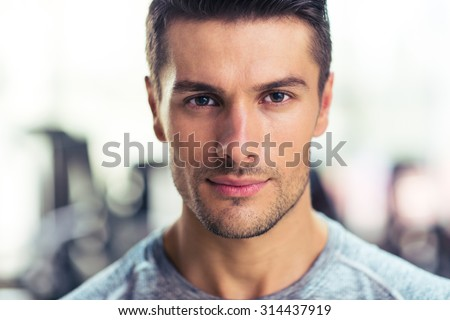 Closeup portrait of a handsome man at gym Royalty-Free Stock Photo #314437919
