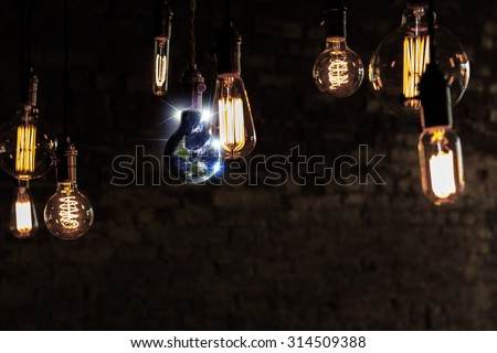 Planet earth and lightbulb for global power and energy concept, Elements of image from NASA #314509388