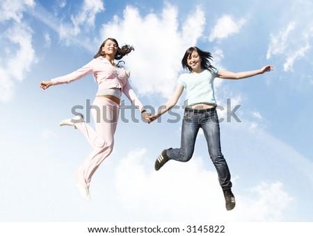 Jumping joyful girls on sky background. #3145822