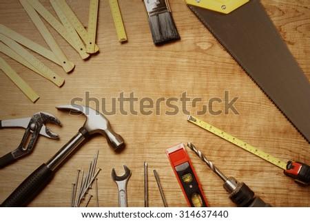Assorted work tools on wood #314637440