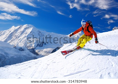 Skier skiing downhill in high mountains, Matterhorn area, Switzerland #314783948