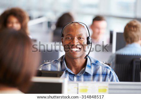 African American man working in call centre, looks to camera #314848517