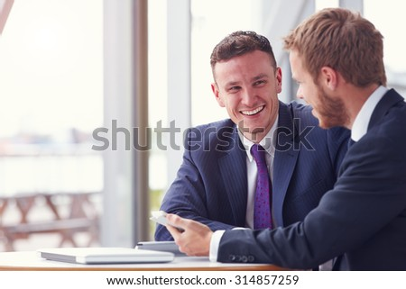 Two business colleagues in a meeting, close up #314857259