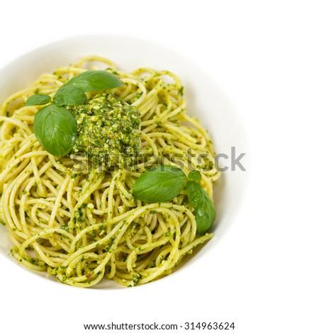 Spaghetti with pesto and basil. Selective focus. #314963624