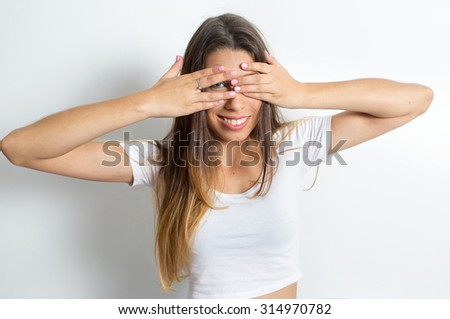 Attractive girl demonstrated emotionally face.Space for copy.White background #314970782
