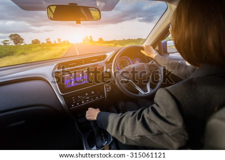 She driving travel in vacation day. #315061121