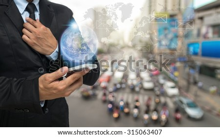 Businessman using the smart phone with earth and world map on abstract Blurred photo of traffic jam with rush hour, Elements of this image furnished by NASA #315063407