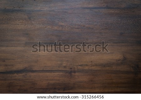 wood brown grain texture, dark wall background, top view of wooden table Royalty-Free Stock Photo #315266456