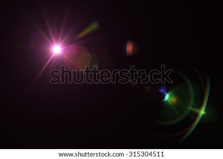 digital lens flare in black background horizontal frame warm #315304511