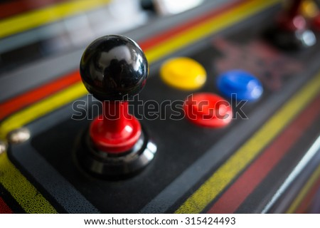 Joystick of a vintage arcade videogame - Coin-Op Royalty-Free Stock Photo #315424493