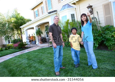 Attractive happy family outside their home having fun #31544056