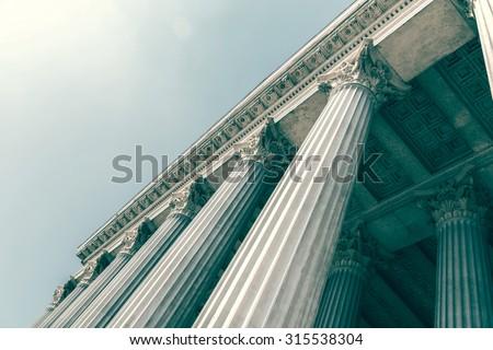 Retro Photo Of Composite Greek Style Columns Royalty-Free Stock Photo #315538304