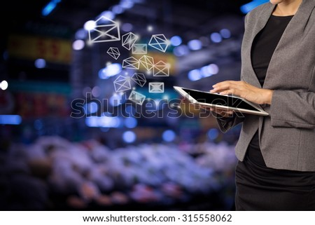 Business woman sending email by using digital tablet #315558062