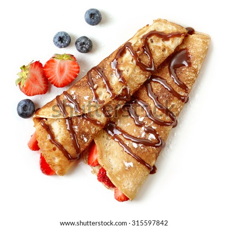 Crepes with strawberries and chocolate sauce isolated on white background Royalty-Free Stock Photo #315597842