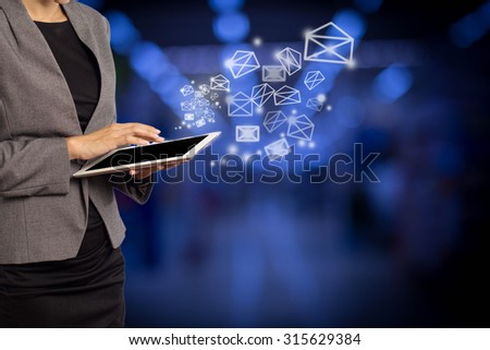 Business woman sending email by using digital tablet #315629384